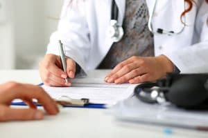 doctor verifying Medicaid coverage for addiction treatment